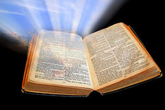 Bible light shines out of darkness Stock Photos