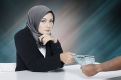 Corruption concept, young women try to bribe somebody Stock Photography