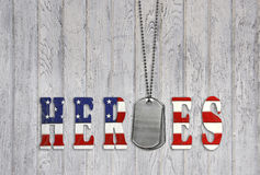 Military dog tags with hero flag Royalty Free Stock Images